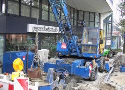 Einbringen der Bohrpfähle mittels Seilbagger und Verrohrungsmaschine